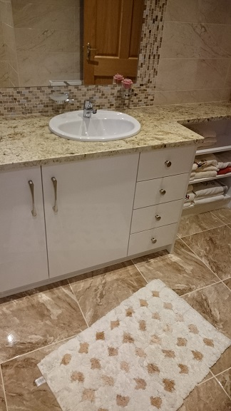 Bespoke Bathroom Unit With White High Gloss Granite Worktop