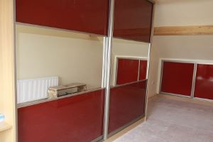 Red Mirrored Built In Wardrobe And Attic Storage