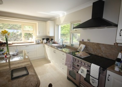 Ivory Kitchen With Island And Granite Windowsill