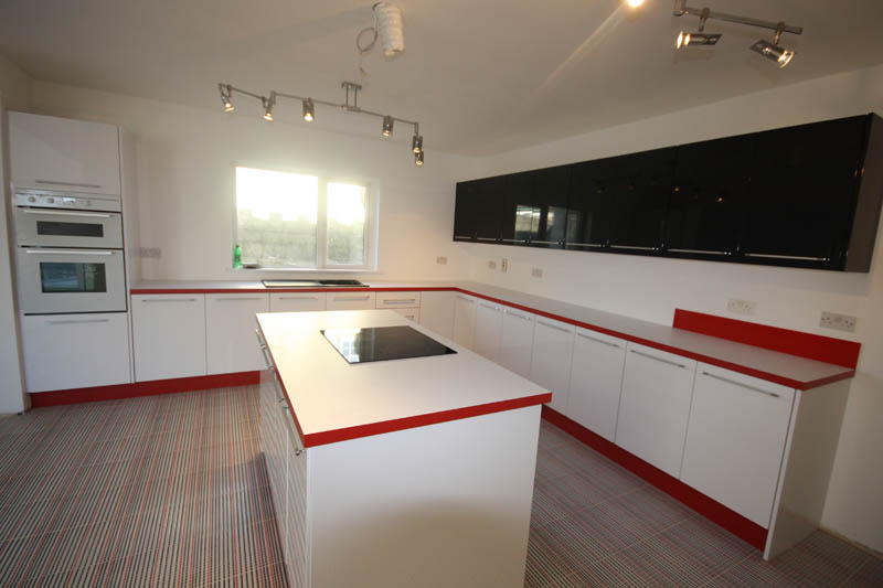 Modern Red And White Worktops With Red Kickboards